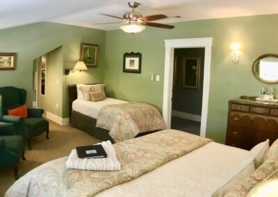 King room with twin bed and private bath ceiling fan antique art work oil paintings California king size bed in canterbury room in ashland bed and breakfast bayberry inn