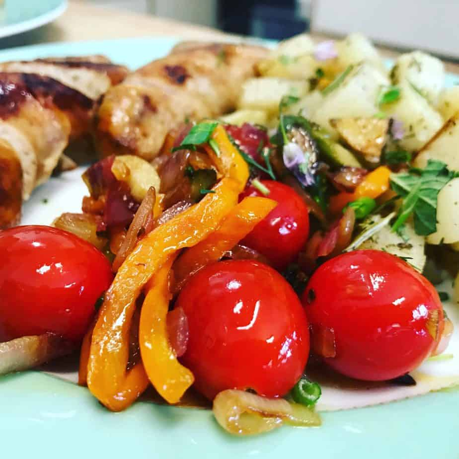 cartelized orange pepper and red onion and roasted cherry tomatoes served with sausage and roasted potatoes for Breakfast